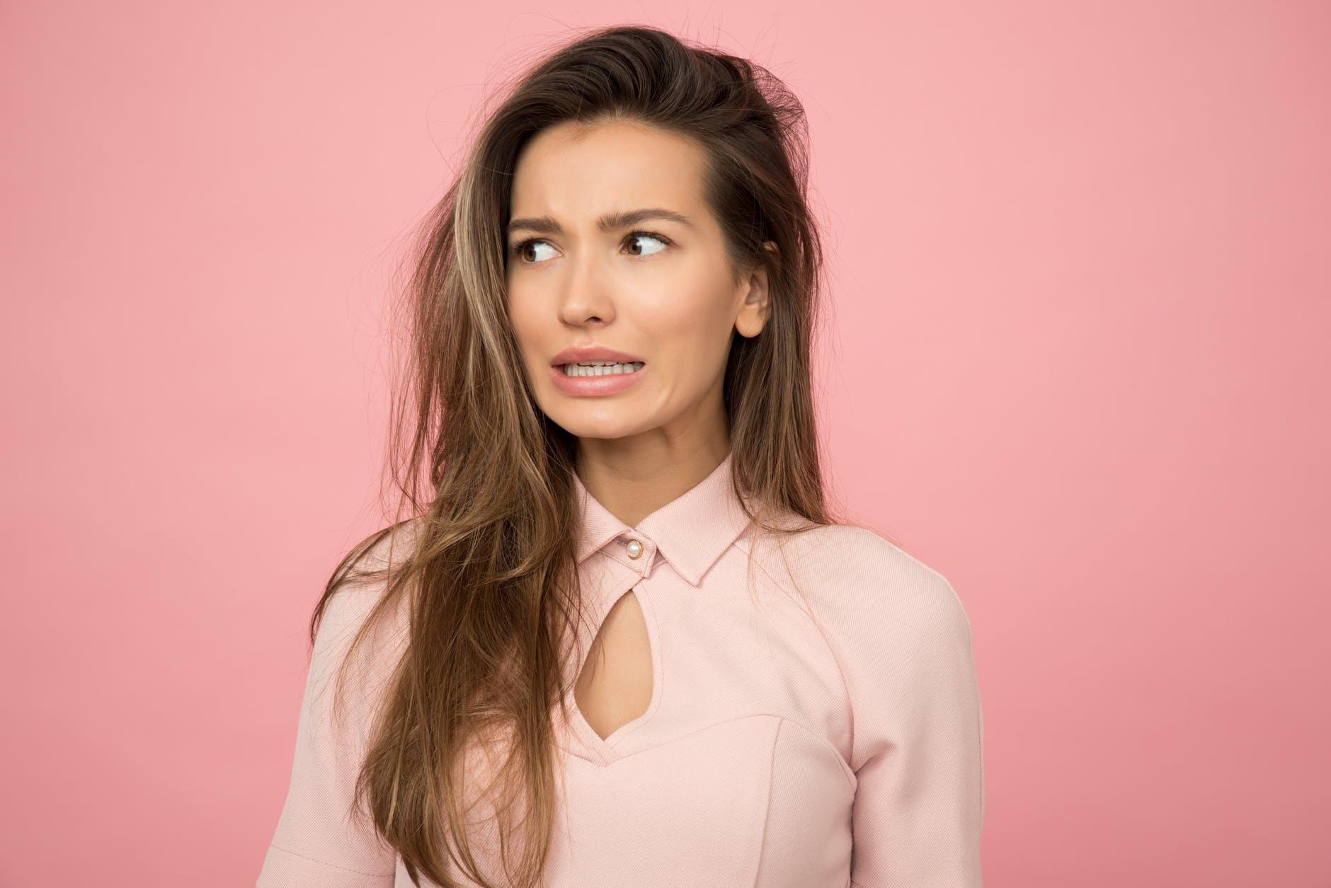 woman wearing pink top